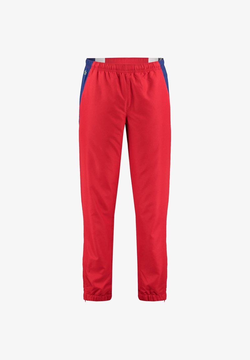 Lacoste Sport - Tracksuit bottoms - blue / red