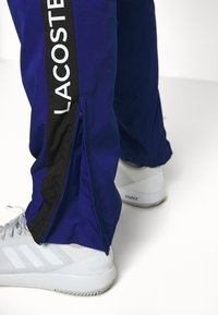 Lacoste Sport - TENNIS PANT - Tracksuit bottoms - cosmic/greenfinch/white/black - 3
