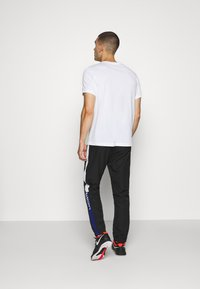 Lacoste Sport - TENNIS PANT - Tracksuit bottoms - black/cosmic white - 2