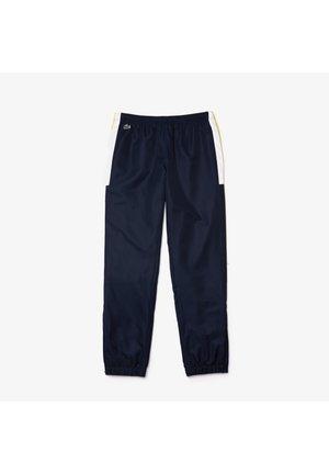 XH4861 - Pantalon de survêtement - navy blau / gelb / weiß
