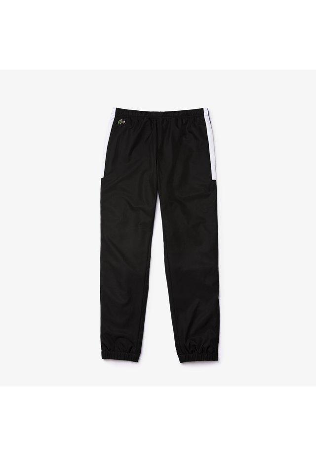 XH4861 - Pantalon de survêtement - schwarz / blau / weiß