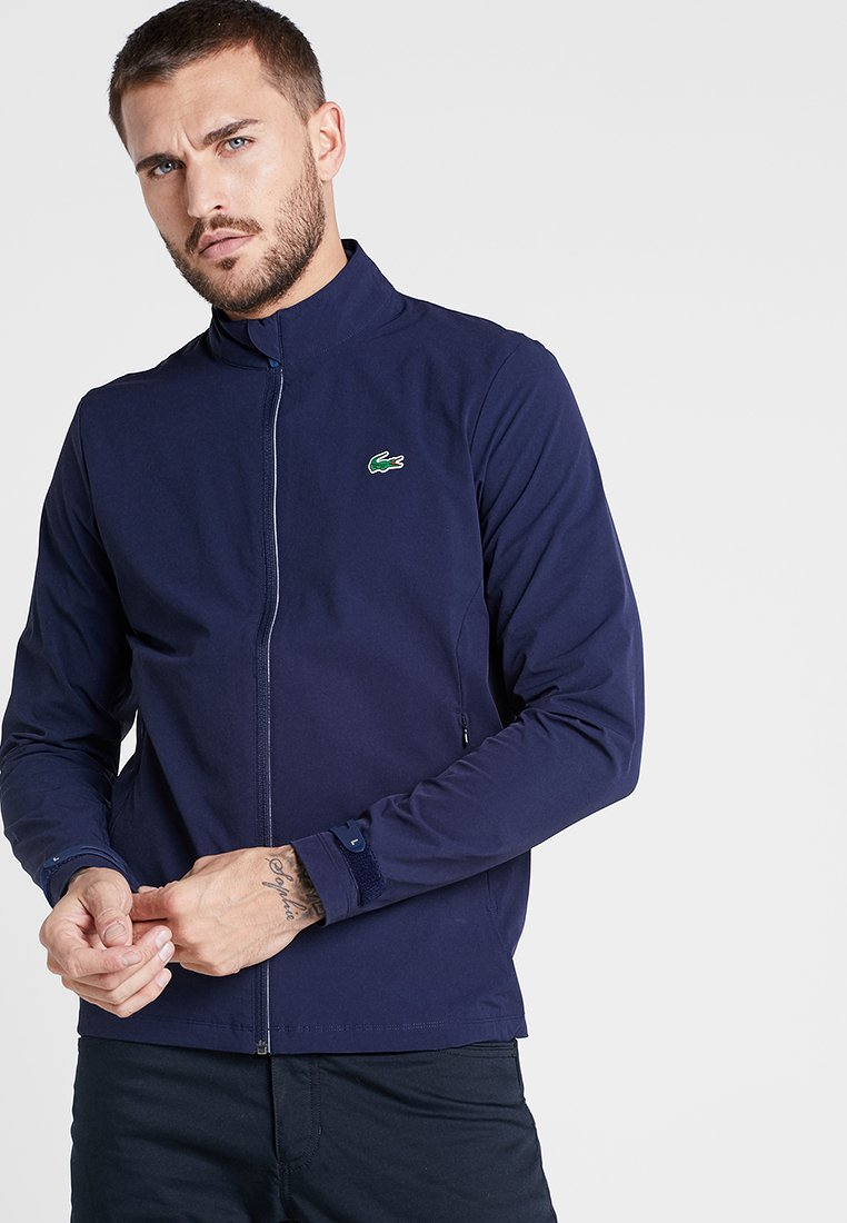 Lacoste Sport - GOLF JACKET - Waterproof jacket - navy blue