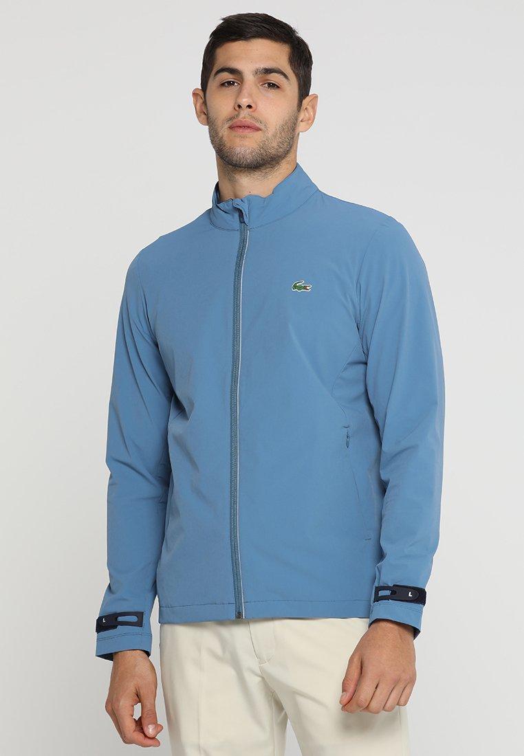 Lacoste Sport - GOLF JACKET - Waterproof jacket - neottia/navy blue