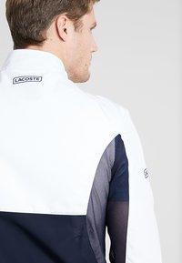 Lacoste Sport - TENNIS JACKET DJOKOVIC - Träningsjacka - white/navy blue - 4