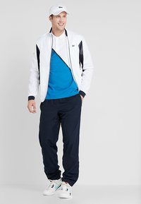 Lacoste Sport - TENNIS JACKET DJOKOVIC - Träningsjacka - white/navy blue - 1