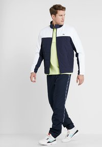 Lacoste Sport - TENNIS JACKET - Outdoor jacket - navy blue/white - 1