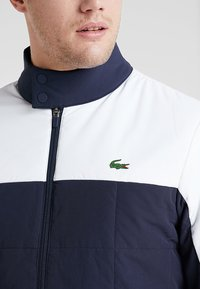 Lacoste Sport - TENNIS JACKET - Outdoor jacket - navy blue/white - 6