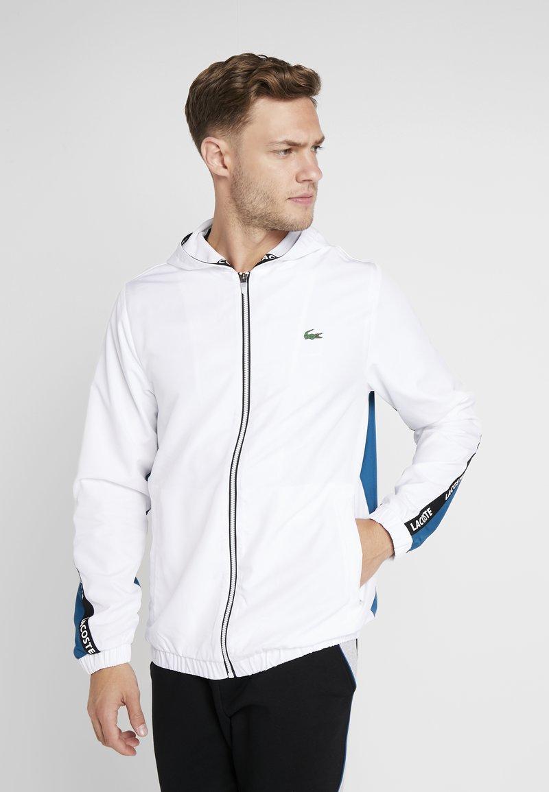 Lacoste Sport - TENNIS JACKET - Training jacket - white/illumination/black