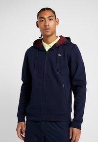 Lacoste Sport - DJOKOVIC - veste en sweat zippée - navy blue/medoc - 0