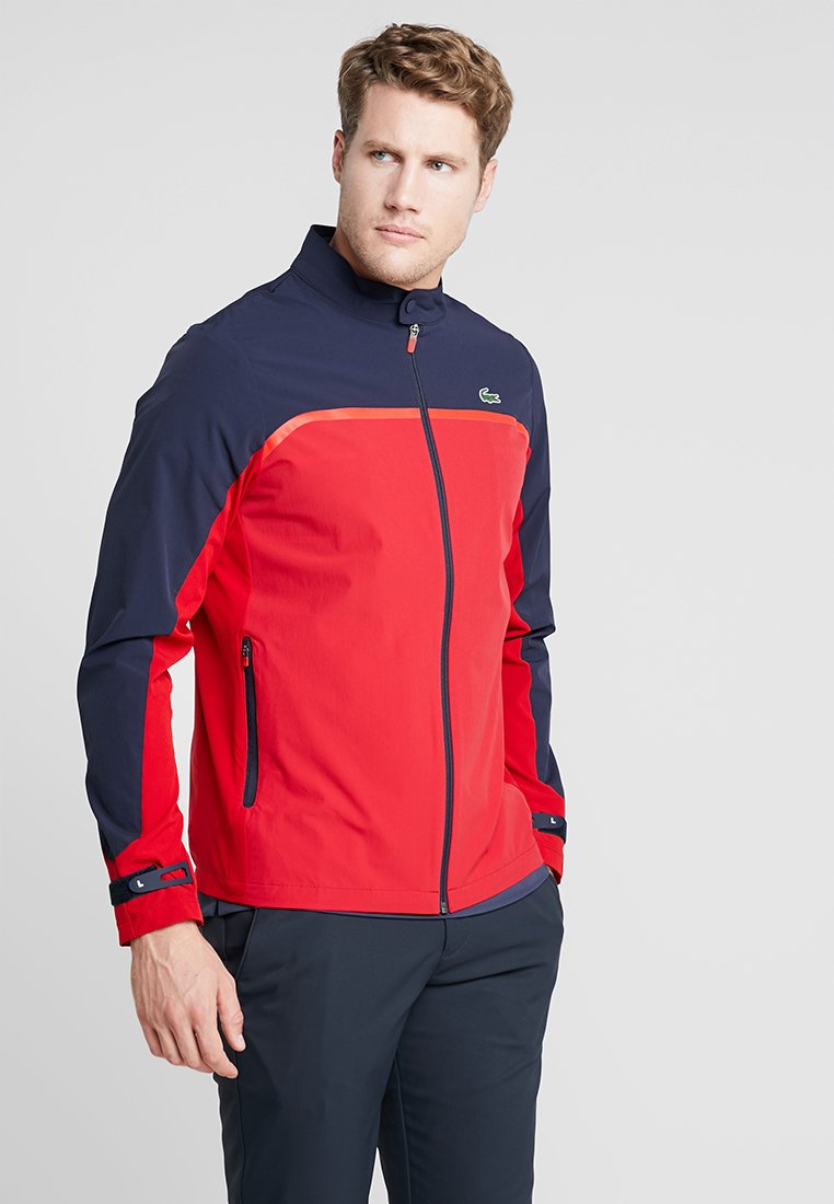 Lacoste Sport - Soft shell jacket - tokyo red/navy blue/flash