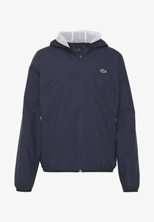 TENNIS JACKET - Waterproof jacket - navy blue/white