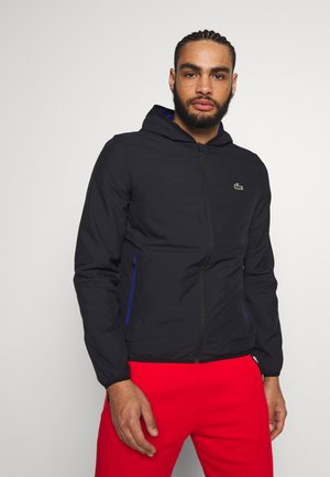 TENNIS JACKET - Regnjacka - black/cosmic
