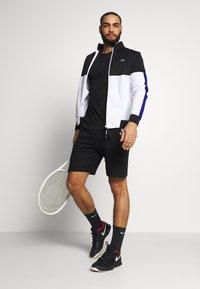 Lacoste Sport - TENNIS JACKET - Training jacket - black/white - 1