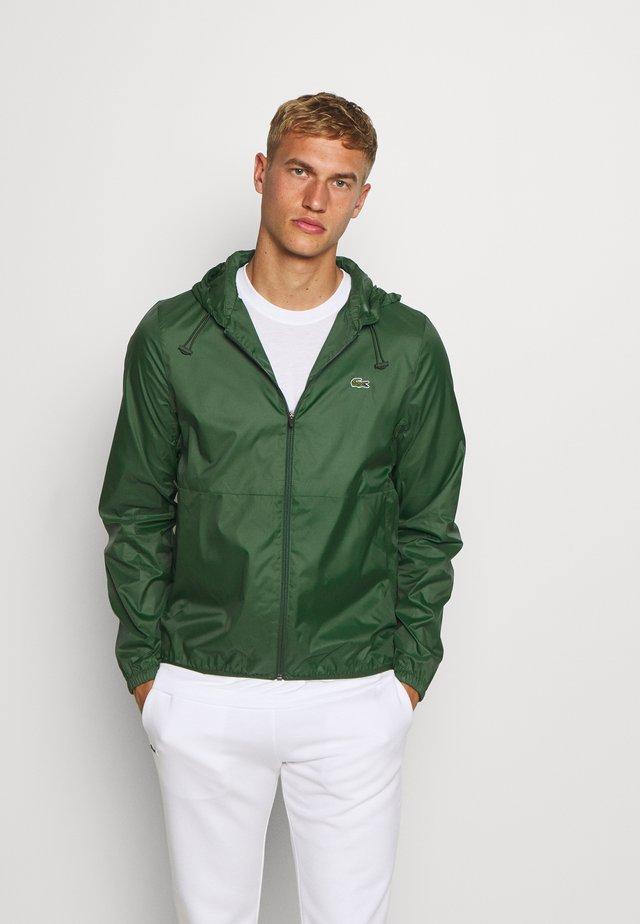 RAIN JACKET - Veste de survêtement - green