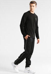 Lacoste Sport - Camiseta de deporte - black - 1