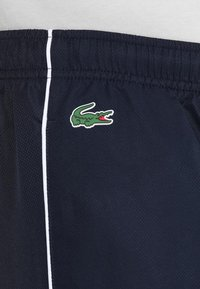 Lacoste Sport - TRACKSUIT - Survêtement - red/navy blue/white - 11