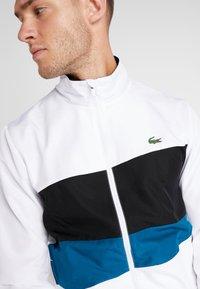 Lacoste Sport - TRACKSUIT - Trainingsanzug - white/black/illumination - 8