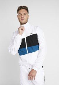 Lacoste Sport - TRACKSUIT - Trainingsanzug - white/black/illumination - 0