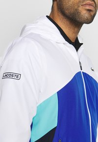 Lacoste Sport - TRACKSUIT HOODED SET - Tracksuit - white/obscurity/navy blue/haiti blue - 6