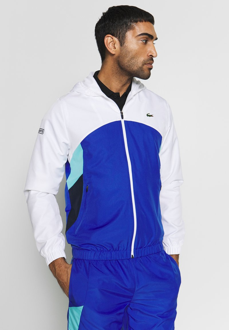 Lacoste Sport - TRACKSUIT HOODED SET - Tracksuit - white/obscurity/navy blue/haiti blue