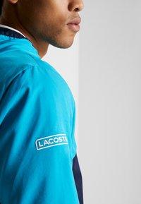 Lacoste Sport - TRACKSUIT HOODED SET - Träningsset - navy blue/haiti blue/lemon/white - 6