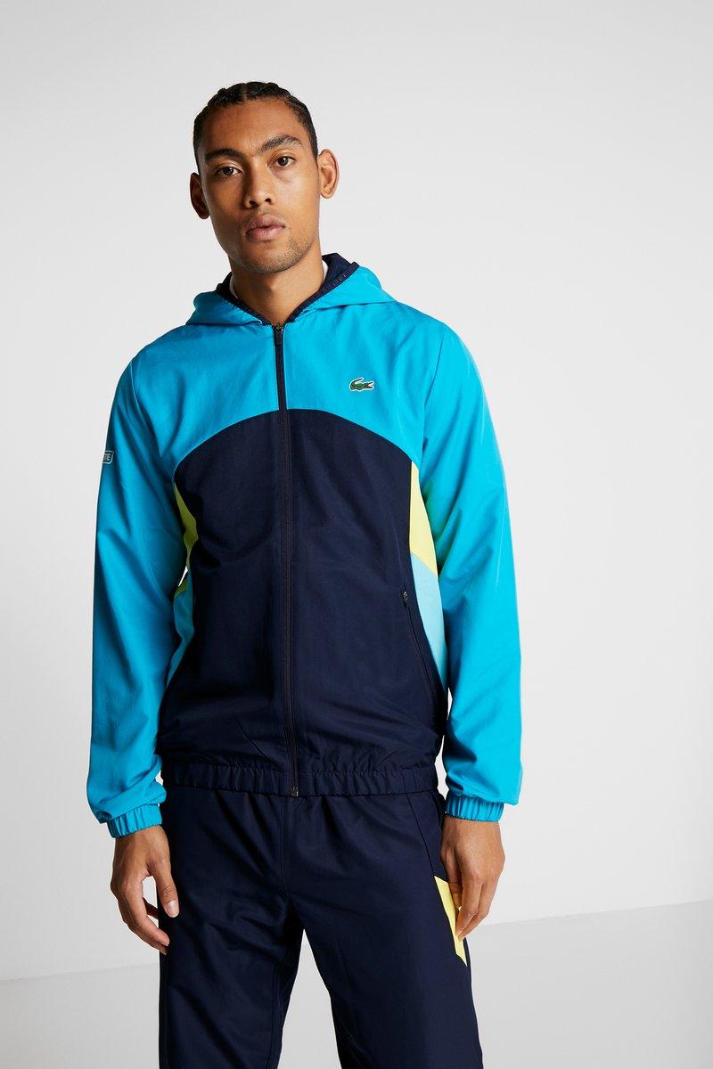 Lacoste Sport - TRACKSUIT HOODED SET - Träningsset - navy blue/haiti blue/lemon/white