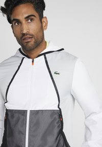 Lacoste Sport - TRACKSUIT HOODED - Träningsset - white/black - 5