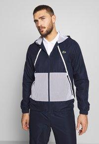 Lacoste Sport - TRACKSUIT HOODED - Survêtement - navy blue/white - 6