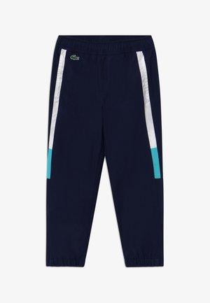 TENNIS PANT - Tracksuit bottoms - navy blue/white haiti/blue