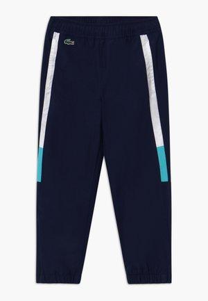 TENNIS PANT - Pantalon de survêtement - navy blue/white haiti/blue