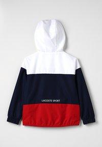 Lacoste Sport - Veste de survêtement - white/navy blue/red - 1