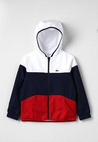 Lacoste Sport - Veste de survêtement - white/navy blue/red - 0