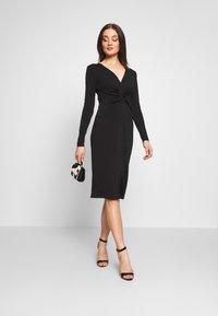 Lost Ink - KNOT FRONT LONG SLEEVE BODYCON DRESS - Pouzdrové šaty - black - 1