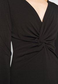 Lost Ink - KNOT FRONT LONG SLEEVE BODYCON DRESS - Pouzdrové šaty - black - 5