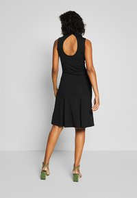 Lost Ink - SLEEVELESS FISHTAIL BODYCON DRESS - Žerzejové šaty - black - 2