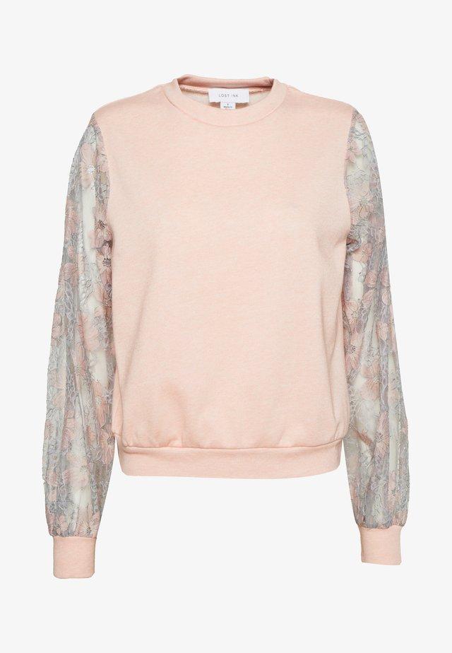 Sweatshirt - apricot melange