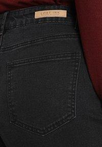 Lost Ink - Flared jeans - washed black - 4