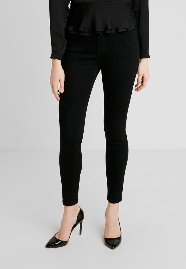 SUPER HIGH WAIST - Skinny-Farkut - black