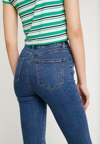 Lost Ink - SLIM - Flared Jeans - mid denim - 3
