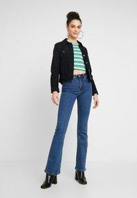 Lost Ink - SLIM - Flared Jeans - mid denim - 1