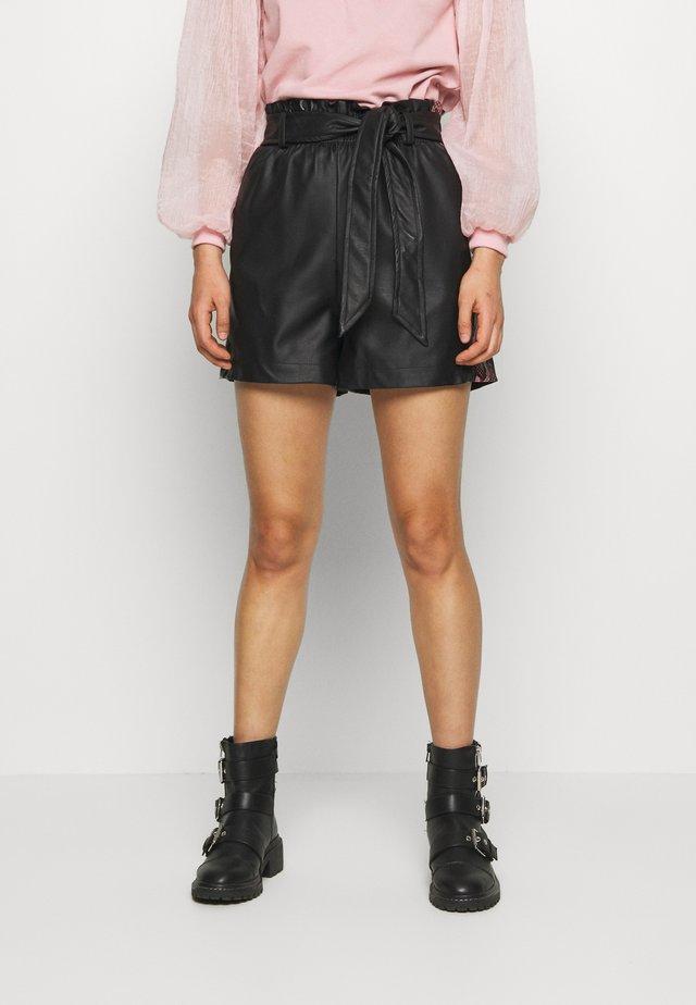 SNAKE SIDE STRIPE - Trousers - black