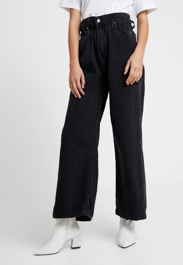 BONNIE - Flared jeans - black