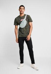Levi's® Extra - 502™ TAPER HI-BALL - Jeans Tapered Fit - black denim - 1