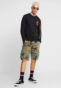 Levi's® Extra - GRAPHIC TEE - Langarmshirt - black - 1