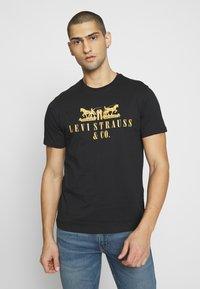 Levi's® - 2-HORSE GRAPHIC TEE - Print T-shirt - black - 0