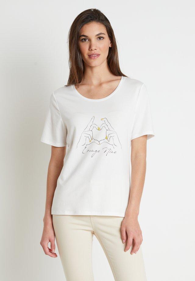 TILDELN - T-shirt med print - chalk