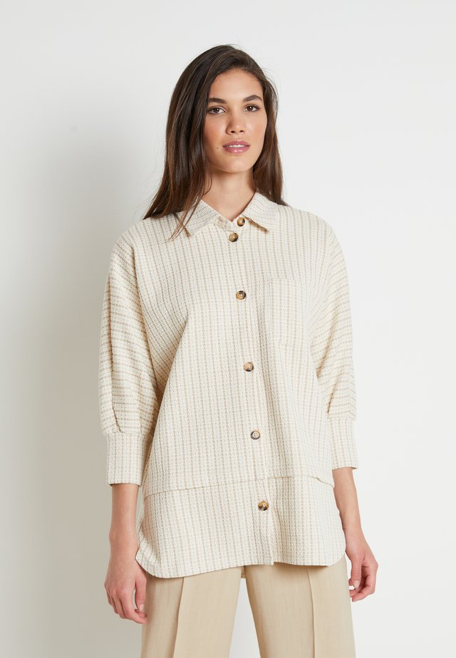 EMILIA - Long sleeved top - beige