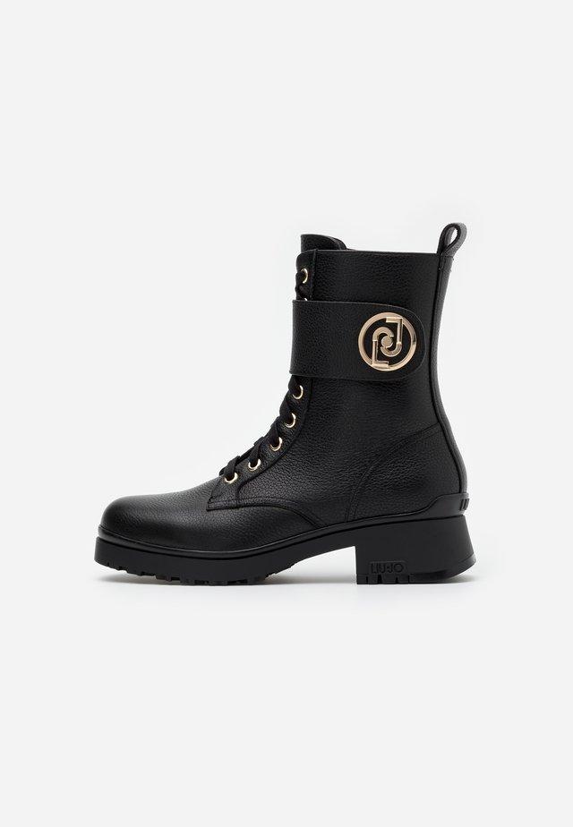NEW NANCY  - Veterboots - black