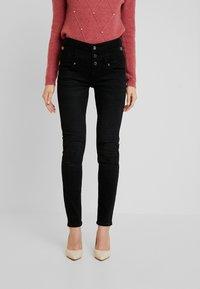 Liu Jo Jeans - RAMPY HIGH WAIST - Slim fit jeans - black - 0