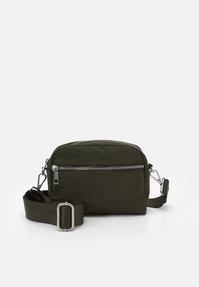 BAG HELLE - Across body bag - dark dusty green